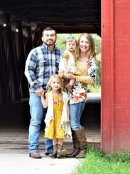 A photo of Vinny and Amanda Gomez and their daughters,