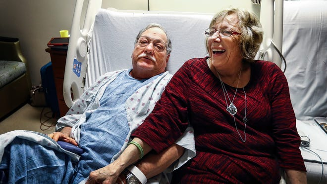 Barbara Sandlin (right) jokes with her husband Gerald in his hospital room at Methodist University Hospital. On Tuesday, Gerald suffered a stoke while the Alabama couple, who have been married for 34 years, was flying home from visiting family in Oregon. The airline made an emergency landing at the Memphis International Airport, where a mobile stroke unit met them on the tarmac. Gerald Sandlin credits the one-of-a-kind specialized ambulance and his doctors with saving his life.