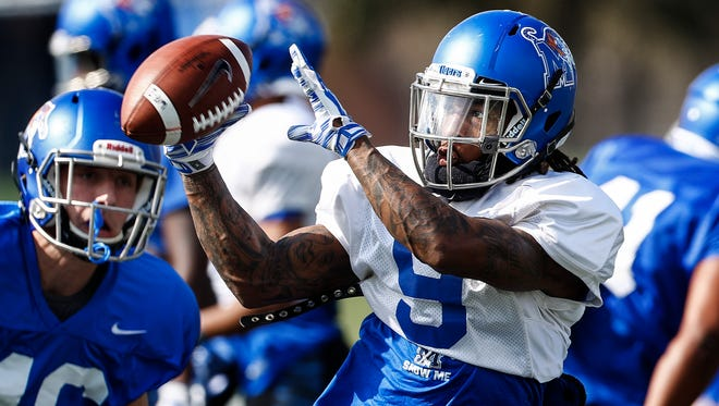 University of Memphis receiver John Williams makes a catch during spring football practice.