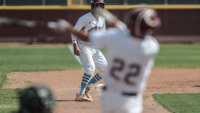 Rancho Mirage's Michael Macias bats a single to allow Ryan Rodriguez on third base to score against Twentynine Palm on Tuesday, May 8, 2018 in Rancho Mirage.