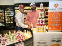 Qasim Khan (left) and his brother Asim Khan launched a line of curcumin-infused beverages, ZYN, in November.