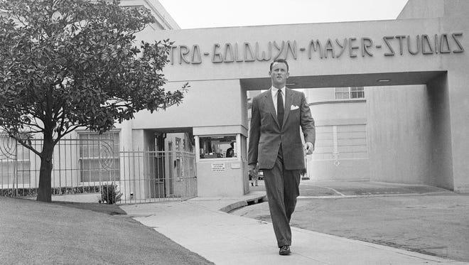 Samuel Goldwyn Jr. poses outside the main gate at Metro-Goldwyn-Mayer studios in Hollywood on April 22, 1959.