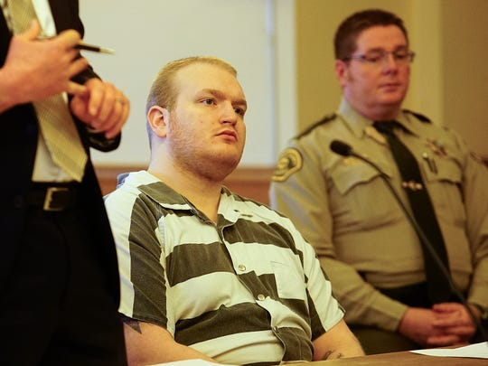 Justin Ray listens to a judge before he is sentenced Friday at the Dallas County Courthouse in Adel.