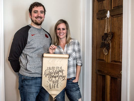 Jenn and Corey Salyer of Cobblestone Road Hand Lettering. Jenn creates handmade calligraphy pieces thats can be displayed on walls or mantles.