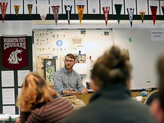 Jason Uitvlugt, Bainbridge High School AP Environmental Science teacher answers questions form his class.