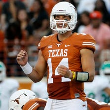 Texas Longhorns quarterback David Ash calls a timeout against the North Texas Mean Green at Darrell K. Royal-Texas Memorial Stadium in Austin on August 30, 2014.