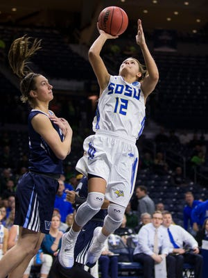 South Dakota State's MacyMiller (12) goes up for a shot next to Villanova's Kelly Jekot during a first-round game in the NCAA women's college basketball tournament Friday, March 16, 2018, in South Bend, Ind. (AP Photo/Robert Franklin)