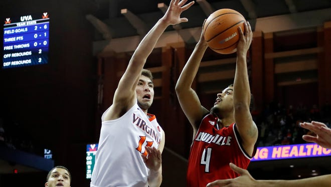 Louisville Cardinals guard Quentin Snider (4) shoots the ball as Virginia Cavaliers guard Ty Jerome (11) defends in the first half at John Paul Jones Arena in Charlottesville, Virginia, on Wednesday, Jan. 31, 2018.