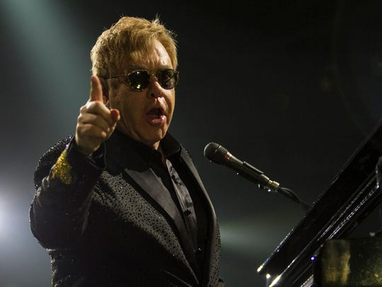 Pop superstar Elton John plays to a sold-out crowd