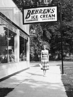Behrens Ice Cream, East State Street, 1950s: A pretty young lady stands in front of Behrens, the popular ice cream-hamburger-grocery store that was in business on the NW corner of East State and 5th from about 1949 to 1973, according to Bette Behrens Kaltenbach. The wooded area in the background was cleared in the 1960s for Rudy's Restaurant, now the site of the CVS Pharmacy.