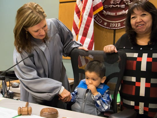 Judge Marci Beyer congratulates Jeremiah Gonzales and