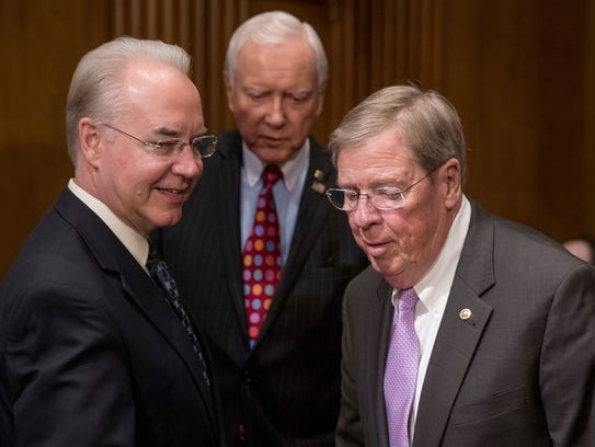 Rep. Tom Price, R-Ga., left, nominee for Health and