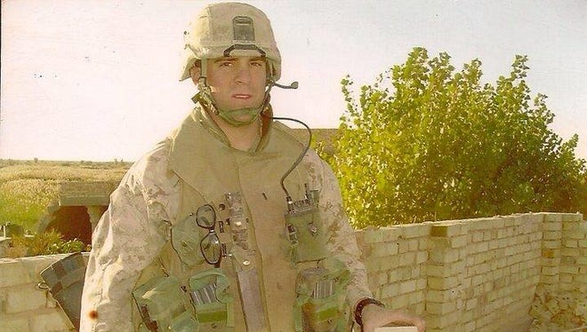 U.S. Marine Corps Lt. Greg Lobato in Fallujah, Iraq, in 2004. Lobato, who was later promoted to captain, was twice denied a job in the Sleepy Hollow Police Department last year. On Tuesday, the board finally voted to hire Lobato and three others.