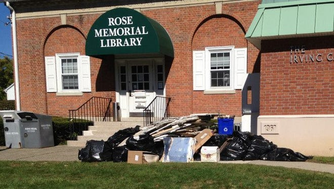 Debris outside the Rose Memorial Library in Stony Point. The library suffered $90,000 in damage last week after a water main flooded and backed up stormwater and sewage into its lower level.