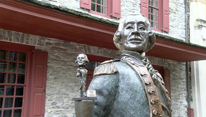 The statue of the Marquis de Lafayette in York along with a bobblehead of the Revolutionary War hero, which will be given away to the first 1,500 fans at the York Revolution baseball game Friday.