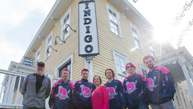 Indigo Spa and Salon owners Melissa Huetter (center) and Chris Huetter (left) with the Whalers.