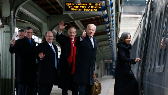 Delawareans (from left) Gov. John Carney, Senator Chris Coons, Senator Tom Carper, Vice President Joe Biden and Congresswoman Lisa Blunt Rochester board an Amtrak Acela train at Union Station bound for Wilmington after attending inauguration events in Washington Friday.