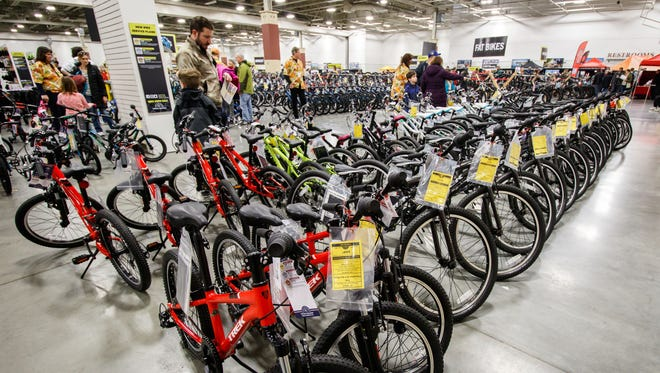 Cycling enthusiasts browse for the perfect ride during Wheel & Sprocket's 34th annual Bike Expo Sale at Wisconsin State Fair Park on Saturday, April 7, 2018. The four-day event features more than 2,000 bikes on sale along with cycling apparel, thousands of accessories and much more.