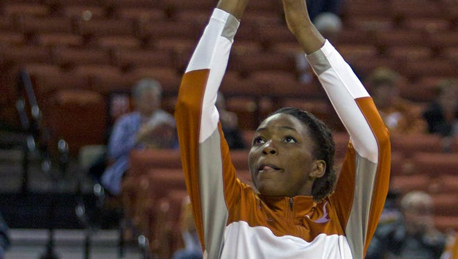 Texas forward Nneka Enemkpali warms up before an NCAA college basketball game against Stanford, Saturday, Nov. 23, 2013, in Austin, Texas.