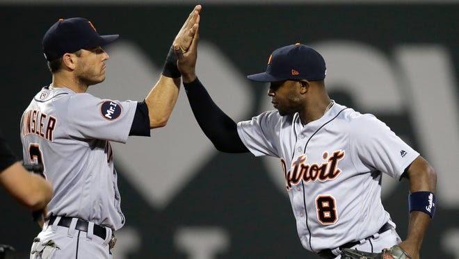 Tigers second baseman Ian Kinsler, left, and leftfielder Justin Upton, right, celebrate the Tigers' 8-3 win over the Red Sox Sunday in Boston.