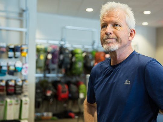 David Hill, owner of Ride On Sports, looks at shoe rack that will need to be reorganized, July 19, 2016. Hill is making changes to his store after it moved to Arroyo Plaza earlier this month.