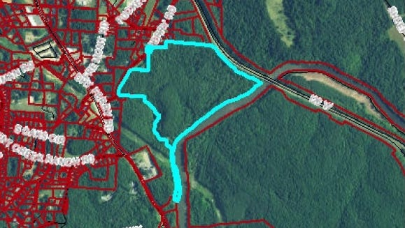 The Ferry Road property owned by Buncombe County is outlined in light blue in this aerial photo. Other property lines are in red.