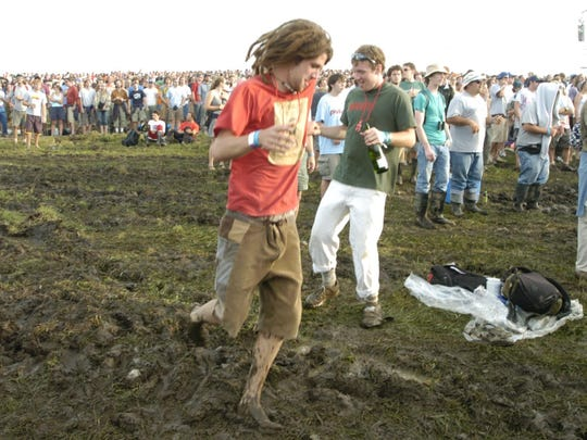 Phish fans dance in the mud during the band's first set on Aug. 14, 2004, in Coventry.