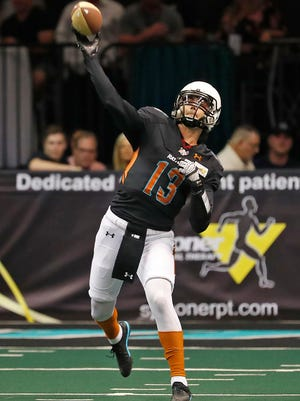 Rattlers quarterback Jeff Ziemba (13) throws a pass against the Titans during the first half at Talking Stick Resort Arena on March 31, 2018 in Phoenix, Ariz.