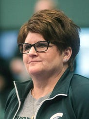 MSU gymnastics head coach Kathie Klages watches the