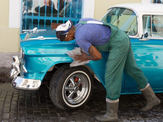 A resident of Havana washes one of the many 1950s-era,