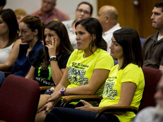 Parents of Green T. Lindon Elementary students listen