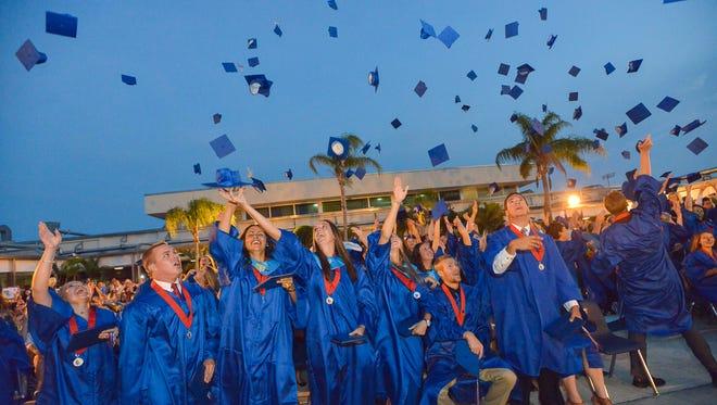 Class of 2015 graduates celebrate at Cocoa Beach Jr./Sr. High School.