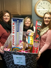 Home caregivers with Comfort Keepers, based in Fayetteville, contributed donations to a toy drive.