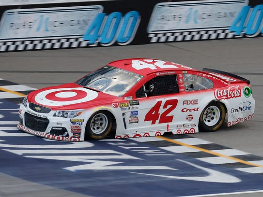Kyle Larson crosses the finish line to win the NASCAR