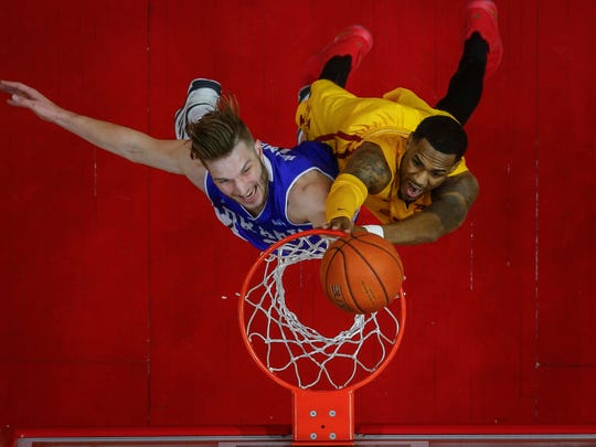 Iowa State senior Monte Morris scores over Drake sophomore Billy Wampler in the second half of the Hy-Vee Classic on Saturday, Dec. 17, 2016, at Wells Fargo Arena in Des Moines.