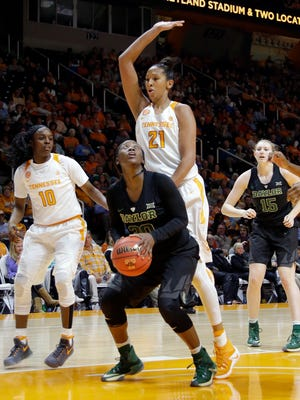 Baylor guard Alexis Jones (30) is defended by Tennessee center Mercedes Russell (21) in the second half of an NCAA college basketball game Sunday, Dec. 4, 2016, in Knoxville, Tenn. (AP Photo/Mark Humphrey)