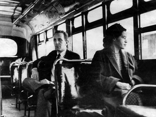 This undated file photo shows Rosa Parks riding on