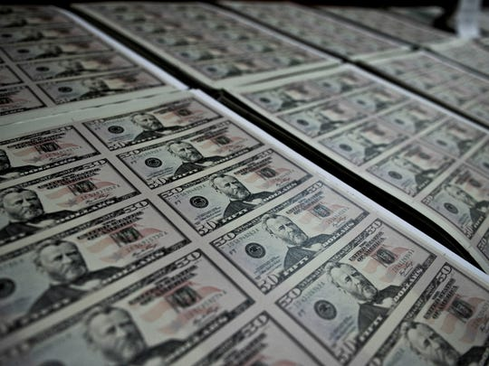 Picture of sheets of counterfeit fifty US dollar  bills, seized by Peru's Department of Criminology (Dirincri), presented to the press in Lima in August 1, 2012. Over two million fake dollars were seized from an international network of counterfeiters trying to send the bills to the US, police said. AFP PHOTO/ERNESTO BENAVIDES        (Photo credit should read ERNESTO BENAVIDES/AFP/GettyImages)