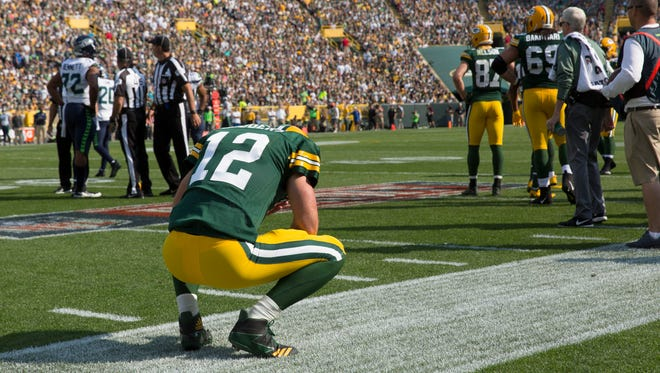 Packers quarterback Aaron Rodgers pauses after throwing an interception against the Seahawks on Sept. 10, 2017, at Lambeau Field.