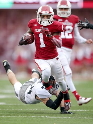 Indiana Hoosiers wide receiver Shane Wynn (1) runs out of the tackle by Purdue Boilermakers safety Landon Feichter (44) for a third quarter touchdown. Indiana University defeated Purdue University 23-16 in the Old Oaken Bucket game Nov. 29, 2014, Bloomington.