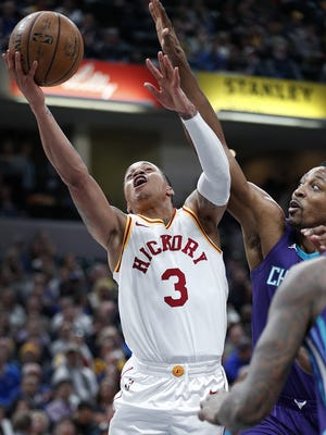 Indiana Pacers guard Joe Young (3) drives by Charlotte Hornets center Dwight Howard (12) in the first half of their game at Bankers Life Fieldhouse on Tuesday, April 10, 2018.