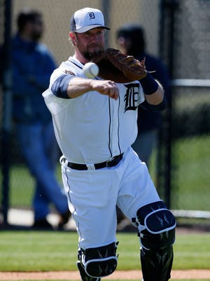 Detroit Tigers catcher Bryan Holaday throws to first base during a fielding drill Friday, Feb. 20, 2015, in Lakeland, Fla.