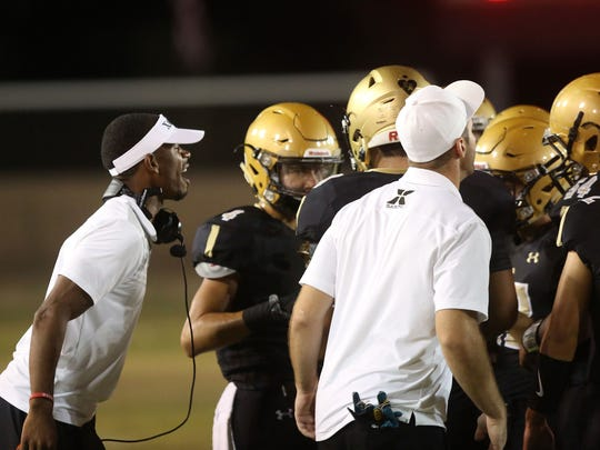 Head Coach James Dockery instructs his players during a timeout  against  Notre Dame, August 25, 2016.