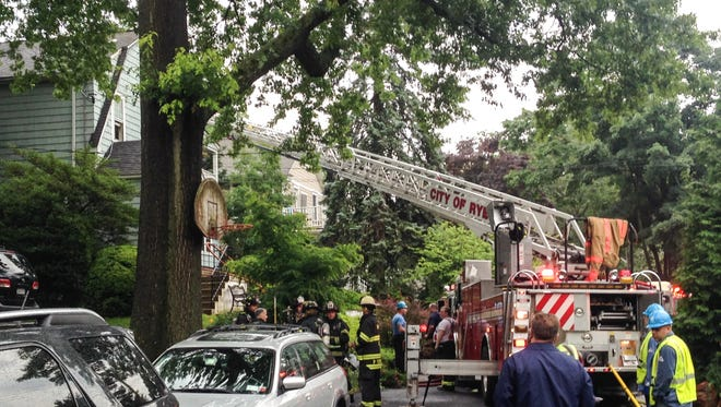Firefighters at the scene of a house fire on Hillside Place in Rye, July 1, 2015.