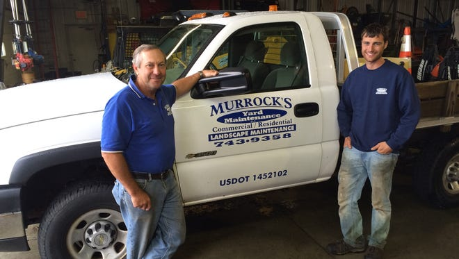 Bill Murrock and Justin Kirwen with one of the Murrock work trucks.