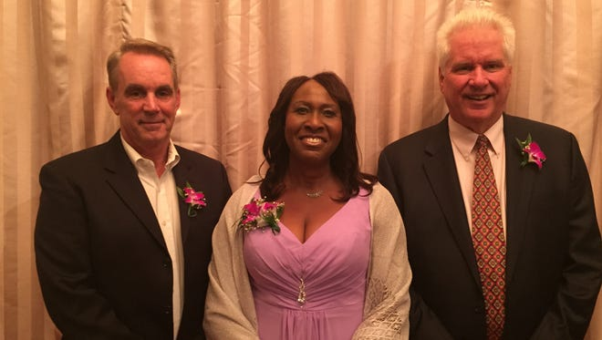 Peter Maher, of Hopewell Junction, Jennis Adams, of Poughkeepsie, and Mark Dennis, of Hopewell Junction, were honored by Grace Smith House at the 2015 Wo(men) of Grace Awards Tuesday.