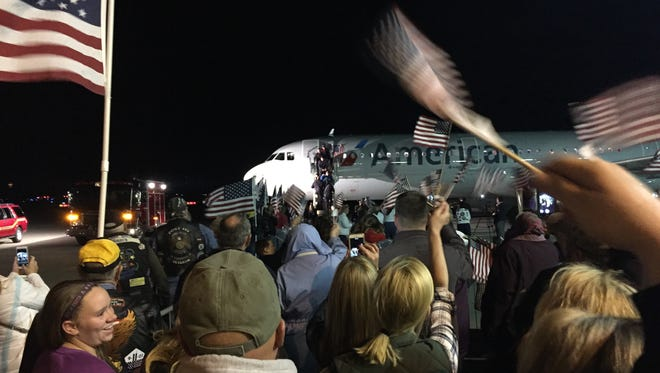 About 300 people came to Purdue Airport Monday night to greet the return of the 12th Greater Lafayette Honor Flight.