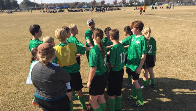 The Visalia AYSO Region 129 area league layoffs included leagues from Mariposa and Porterville. The Maripsoa league (pictured) were unsure about their advancement but upheld their team spirit throughout.