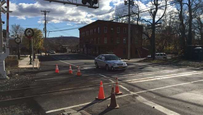 Six orange cones mark off the Lake Road crossing in Congers on Monday, as seen from North Rockland Avenue. Last week, two cars turned onto the tracks and moments later were hit by trains. No one was injured.