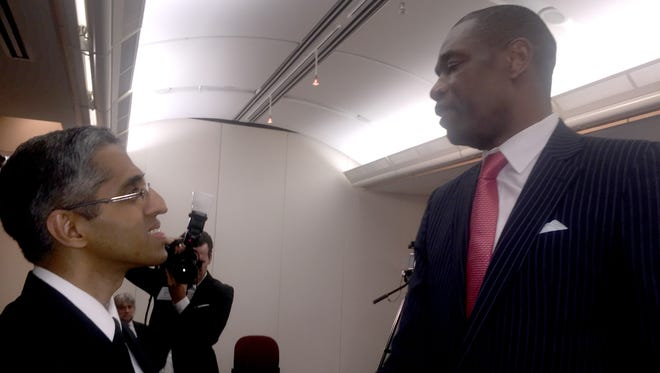 "Surgeon General Vivek Murthy talks with former NBA player Dikembe Mutombo after the Kaiser Permanente-NBA ""Total Health"" forum."